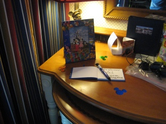 Signed autograph book by Mickey and a signed picture by Mickey AND Minnie