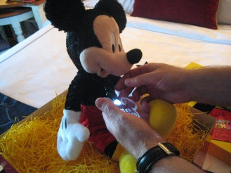 Stuffed Mickey with a lit up Birthday necklace