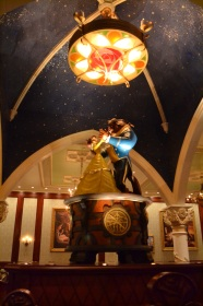 Beauty and the Beast dancing in one of the rooms of Be Our Guest
