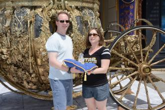 In front of Cinderella's carriage